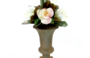 Magnolias and roses in rust urn